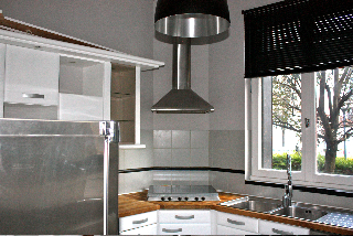 a black blind and this kitchen looks new!