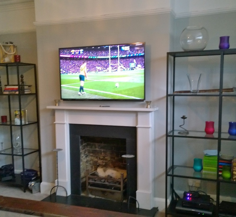 Ikea shelves handy and stylish options on each side of a fire place